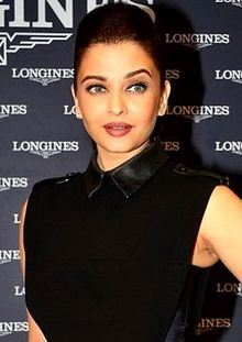 Aishwarya Rai is looking gently towards the camera