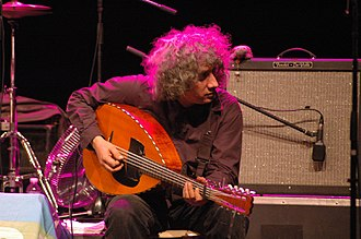 Algerian mandole - Hakim Hamadouche playing a 10 string electric mondole in Marseilles.