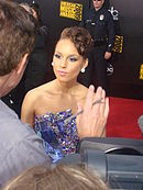 A woman being interviewed on the red carpet