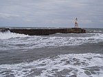 Amble north pier light in heavy seas - geograph.org.uk - 1094269.jpg