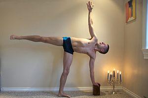 English: Ardha Candrāsana-half-moon yoga posture