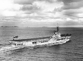 Aircraft carrier - An F6F-5 landing on the French Arromanches in the Tonkin Gulf, 1953.