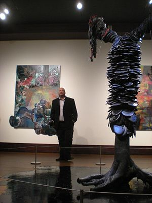Jeffrey Gibson - Gibson speaking at the Eiteljorg Museum in 2009. His artwork Mythmaker is in the foreground and Second Nature in the background.