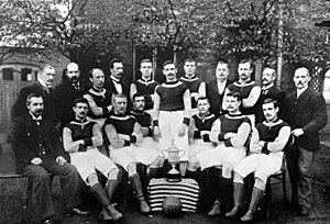 1895 FA Cup Final - Aston Villa players posing with the trophy