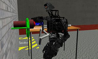 Atlas (robot) - An Atlas robot connects a hose to a pipe in a Gazebo computer simulation