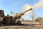 Australian soldiers from the 8-12 Field Regiment firing a M777 155mm howitzer.jpg