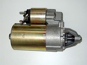 Starter (engine) - An automobile starter motor (larger cylinder). The smaller object on top is a starter solenoid which controls power to the starter motor.