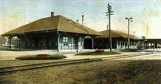 Ayer, Massachusetts - Postcard view showing the two railroad stations that once served Ayer, dated 1910