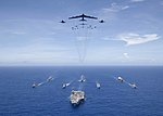 B-52 and FA-18 aircraft flying over the Carrier Strike Group Five during Valiant Shield 2018.jpg
