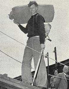 B. Gunn boarding the HMNZS Endeavour in Dunedin, 1956.jpg