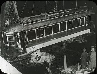 Summer Street Bridge disaster - The streetcar being raised from the river the next day