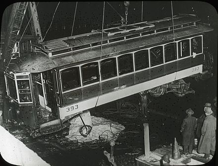 The tram being raised from the river, a day after the disaster that saw it fall off an open drawbridge. BERy 393 being raised from Fort Point Channel, November 8, 1916.jpg
