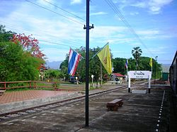 Ban Pin railway station with the Phi Pan Nam Range in the background. Long District