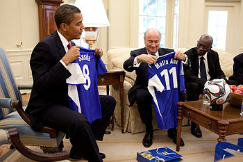 English: President Barack Obama is presented w...