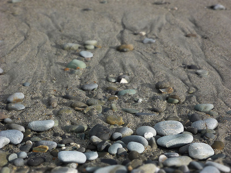File:Beach stones and sand.JPG
