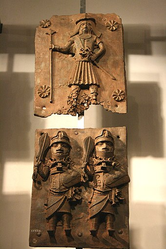 Two brass plates depicting a bearded Portuguese soldier before 1500 on top and Benin warriors at the bottom Benin brass plaque 05.jpg