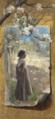 Bertha Wegmann, Trompe l'oeil med en lille pige stående under et blomstrende æbletræ på et lærred fastgjort på en væg under en blomstrende æblegren.png