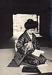 Billet-Doux - Japanese woman writing a letter on paper roll with an ink brush (1911 by Elstner Hilton).jpg