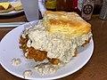 Biscuit with fried chicken thigh & sausage gravy at Biscuit Love in Nashville, TN.jpg