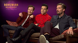 Bohemian Rhapsody (film) - (Left to right) Joe Mazzello, Rami Malek, and Gwilym Lee promoting the film in 2018.