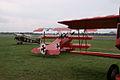 Bowers 1B Fokker Dr.I under Fokker DVII wing Dawn Patrol NMUSAF 26Sept09 (14619993223).jpg