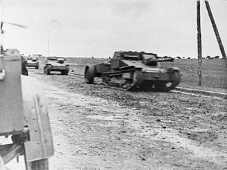 Battle of Guadalajara - Italian tankettes advancing with a flame thrower tank in the lead at Guadalajara.