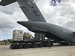 C17 (AK 80051) unloading at Comodoro Rivadavia (37695335455).jpg