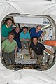 COTS-2 Dragon Cargo Spacecraft with Six Astronauts at the Space Station.jpg