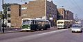CTA Pullman trolley bus 9338 and UMC bus 131, Irving Park Rd, 1968.jpg