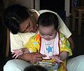 Caretaker reads with child.jpg