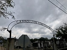 Arched iron gateway over the entrance to Carrollton Cemetery No.1 at Adams and Green Streets in New Orleans, Louisiana
