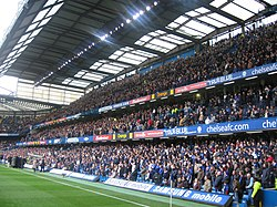 The East Stand during a match in 2006. The cost of building this stand caused many of Chelsea's financial problems during the 1970s and 1980s.