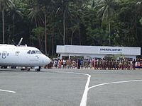 Chiefs+politicians parading round plane 3.jpg