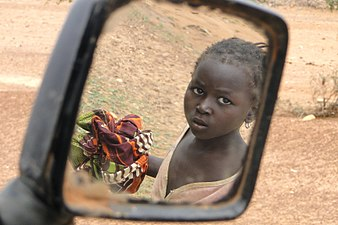 Child's Reflection in Minibus Mirror - En Route to Bani - Sahel Region - Burkina Faso.jpg
