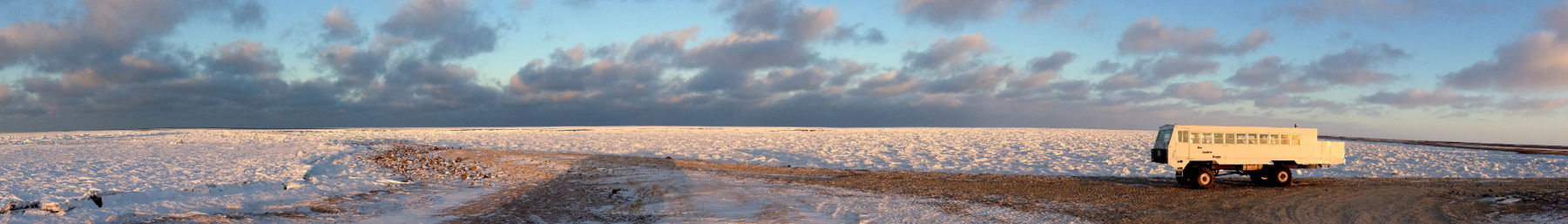 A tundra vehicle by the shore of Hudson Bay in November