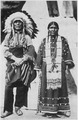 Circus Sarrasani - Two Sioux Indians in native dress in front of teepee - NARA - 285600.tif