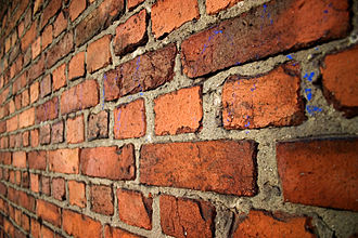 Brick - An old brick wall in English bond laid with alternating courses of headers and stretchers