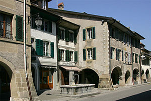 Coppet - Fountain and arcades in Coppet