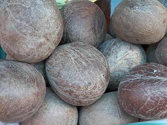Copra - Whole dry coconuts, kept for sale in Ulsoor Market, Bangalore, India