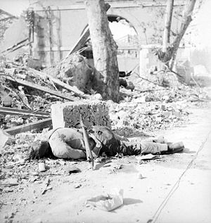 Battle of Toulon (1944) - One German corpse laying on the streets of Toulon, photography of Laurence Le Guay.