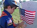 Cub scout salutes Fort Sam Houston Cemetery with flags of honor.jpg