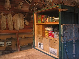 Old Trail Town - Stocked cupboard in mountain man's cabin at Old Trail Town