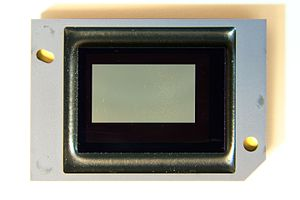 "Digital micromirror device - A broken DMD chip showing the ""white dots"" appearing on screen as ""white pixels""."