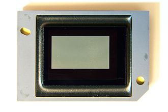 """Digital micromirror device - A broken DMD chip showing the """"white dots"""" appearing on screen as """"white pixels""""."""