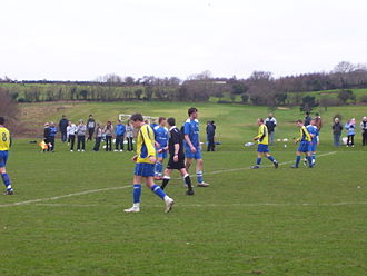 Douglas and District F.C. - Douglas and District (in yellow) in an Isle of Man FA Cup match against Douglas High School Old Boys F.C. during the 2008–09 season
