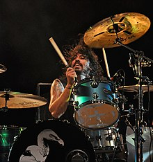 Dave Grohl playing drums.