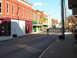 Downtown Horse Cave, December 2006, looking eastward down Main Street/HWY-218. The cave opening is to the right.