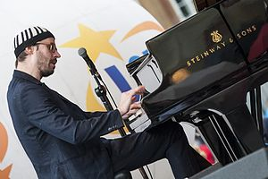 David Helbock - David Helbock on piano during an open-air concert in The Old Town's Square in Warsaw, Poland on July 16, 2016.
