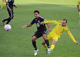 Dwayne De Rosario - De Rosario is challenged by Rich Balchan in a 2011 regular season match