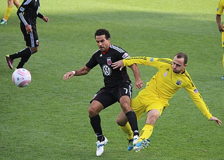 De Rosario is challenged by Rich Balchan in a 2011 regular season match De rosario-balchan.jpg